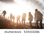 Group Of Hikers Walking On A...