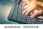 man's hand on computer keyboard | Shutterstock . vector #524354146