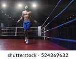 jumping young man in boxing ring | Shutterstock . vector #524369632