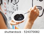 young woman painting a picture... | Shutterstock . vector #524370082