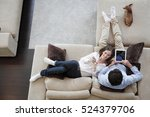 Couple Using Digital Tablet At...