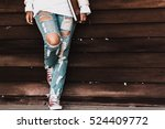 Young fashion woman's legs in...