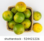 Oranges In A Basket Isolated O...