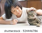 Small photo of Selective focus on adorable Asia kid girl playing with Thai cat. Little happy Asian child lay down softly touching her pet at head.Love Your Pet Day.Random Acts of Kindness Week.Be kind to Animals