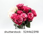 Stock photo roses in a jar over the white isolated background 524462398