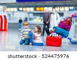 Small photo of Two little kids, boy and girl with suitcases at the airport, indoors and waiting for family vacations. Happy children, twins, brother and sister exciting about air travel trip and flying with airplane