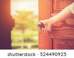 women hand open door knob or... | Shutterstock . vector #524490925