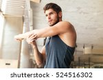 fitness man warming up in gym.... | Shutterstock . vector #524516302