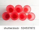 Red Plastic Cups On A White...