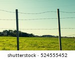 Barbered Fence On Meadow