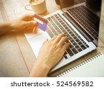 businessman hand holding credit ... | Shutterstock . vector #524569582