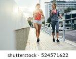 women jogging in city in dusk... | Shutterstock . vector #524571622