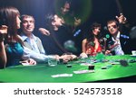 poker players sitting around a... | Shutterstock . vector #524573518