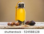 bottle of argan oil and fruits... | Shutterstock . vector #524588128