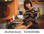 Young Woman Baking Christmas...