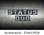 Small photo of status quo stencil print on the grunge white brick wall