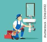 plumber repairing pipe on...