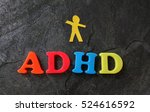 Small photo of Paper child cutout with ADHD spelled out in play letters