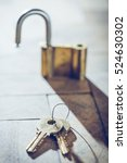 padlock and keys on wood. back... | Shutterstock . vector #524630302