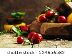 various tomatoes on old wooden... | Shutterstock . vector #524656582