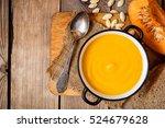 bowl of pumpkin soup on rustic... | Shutterstock . vector #524679628