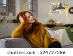 redhead woman sitting at home... | Shutterstock . vector #524727286