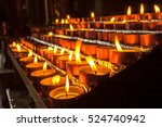 group of votive candles burnt... | Shutterstock . vector #524740942
