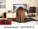 girl watching tv with dog | Shutterstock . vector #524749372