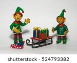 two christmas elf with gifts | Shutterstock . vector #524793382
