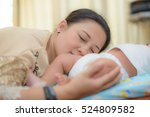 asian mother and her baby... | Shutterstock . vector #524809582