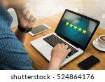 businessman holding five star...   Shutterstock . vector #524864176