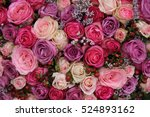 Stock photo pink and purple roses in a wedding flower arrangement 524893162