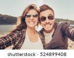 two lovers making funny selfie | Shutterstock . vector #524899408