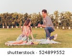 young man makes a proposal of... | Shutterstock . vector #524899552