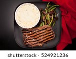 Small photo of char grilled ribeye beef steak with cauliflower gratin and beans with mushrooms