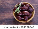 red kalamata olives on a wooden ... | Shutterstock . vector #524928565