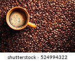 roasted coffee beans and cup of ... | Shutterstock . vector #524994322