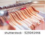 close up clothes hang on... | Shutterstock . vector #525041446