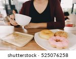 woman in cafe with donut and... | Shutterstock . vector #525076258