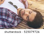 young man sleep on bamboo bed.   Shutterstock . vector #525079726