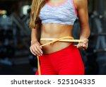 woman measuring perfect shape... | Shutterstock . vector #525104335