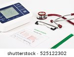 Stock photo vitals sign chart medical graphs and measuring blood pressure with red stethoscope on white 525122302