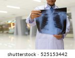 doctor looking chest x ray film ... | Shutterstock . vector #525153442