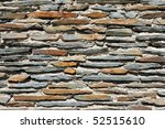 Fragment Of A Stone Wall Made...