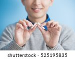 man quit smoking with blue... | Shutterstock . vector #525195835