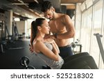 personal trainer helping woman... | Shutterstock . vector #525218302