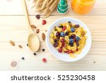 corn flakes and berries on... | Shutterstock . vector #525230458