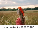 long haired girl with a poppy... | Shutterstock . vector #525259186