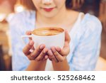 closeup of female hands holding ... | Shutterstock . vector #525268462
