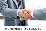 closeup of a business handshake | Shutterstock . vector #525283762